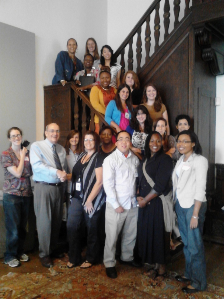17 AmeriCorps members on a staircase with trainers