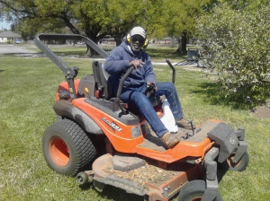 Thomas the groundskeeper on his riding lawnmower.