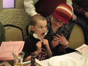 Kid yelling with utensils