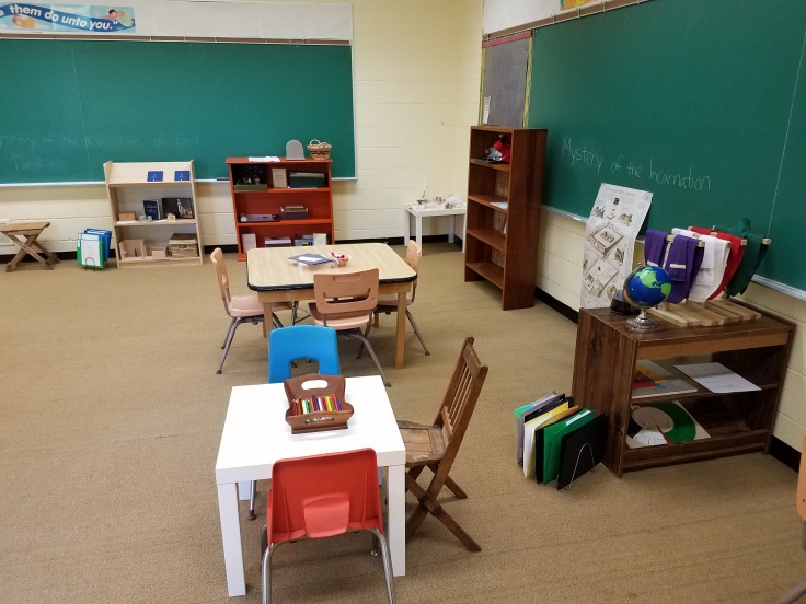 Short bookcases and pre-school sized desks and chairs